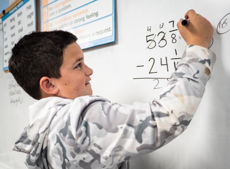 kid at whiteboard